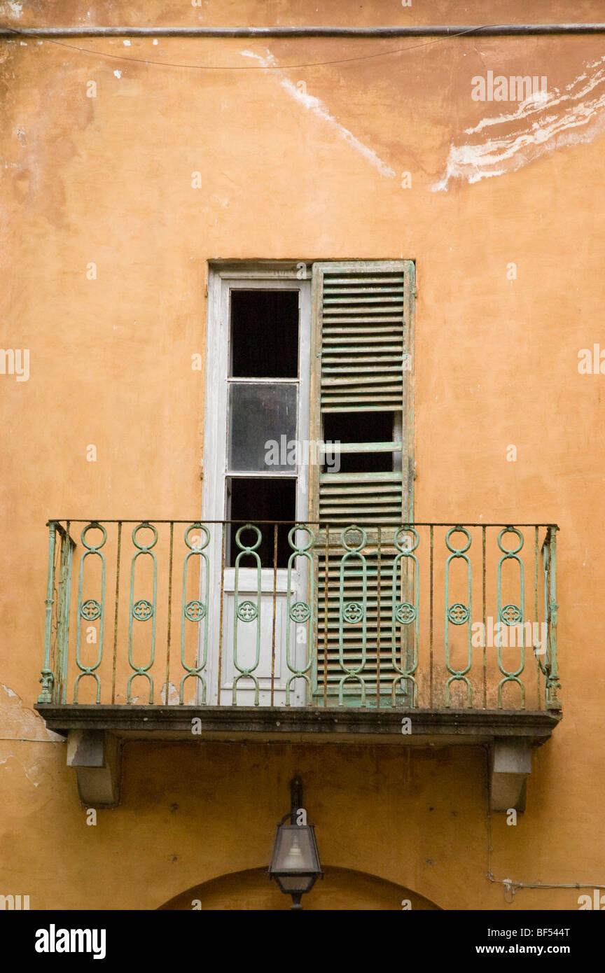 broken window shutter and veranda run down Italian House - Stock Image