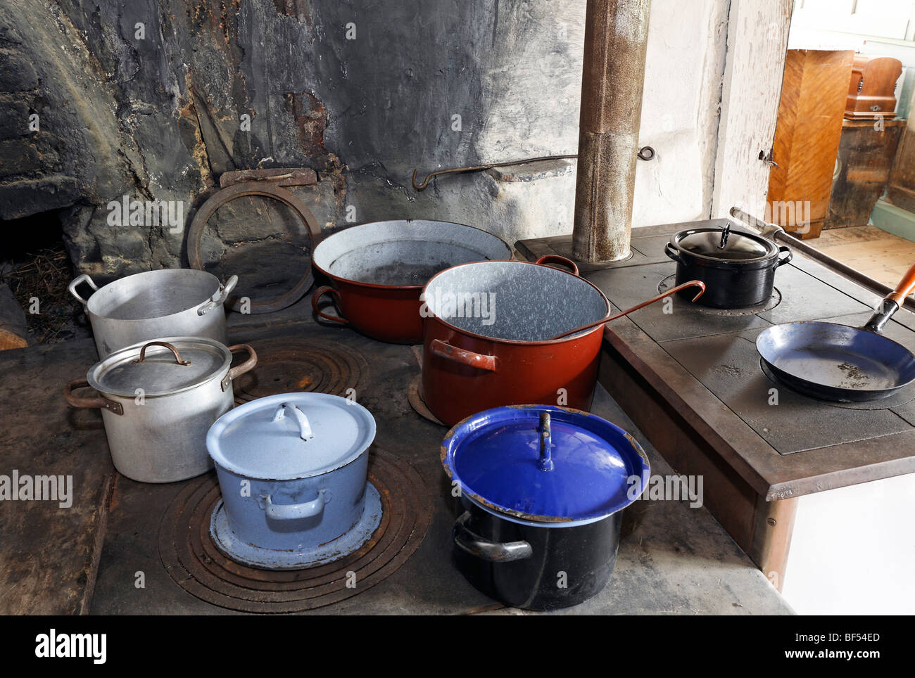 Pots on an old wood stove, kitchen in the Haus Andrinet house from 1740, Wolfegg farmhouse museum, Allgaeu region, - Stock Image