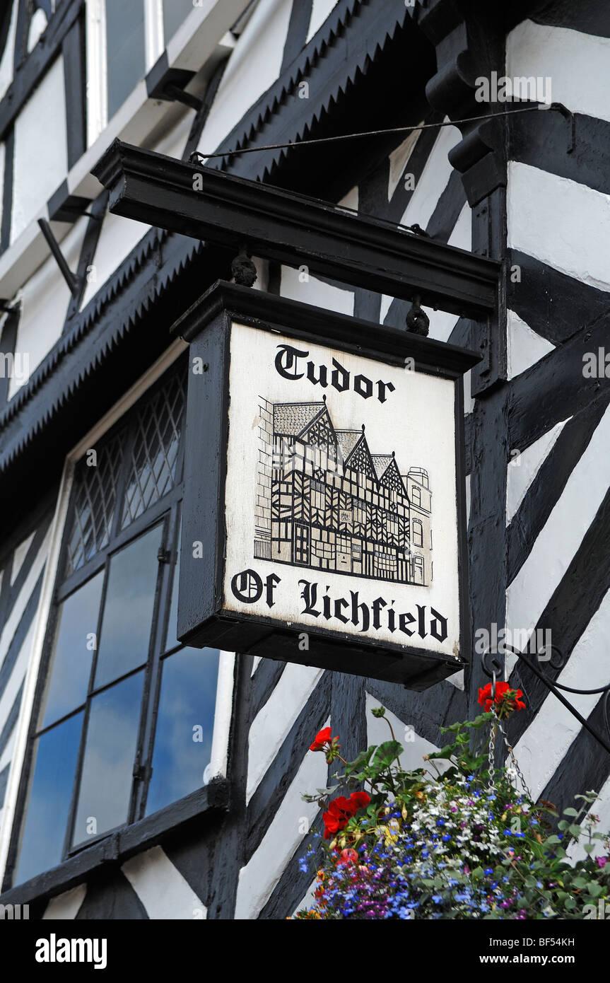 Old pub sign, Tudor of Lichfield, on a half-timbered Tudor-style house, Bore Street, Lichfield, Staffordshire, England, Stock Photo