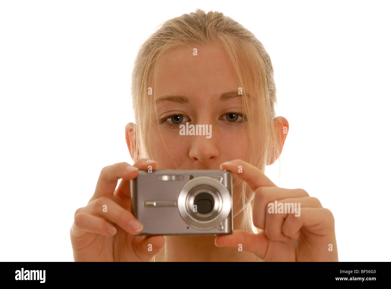 Eighteen year old woman with a digital camera - Stock Image