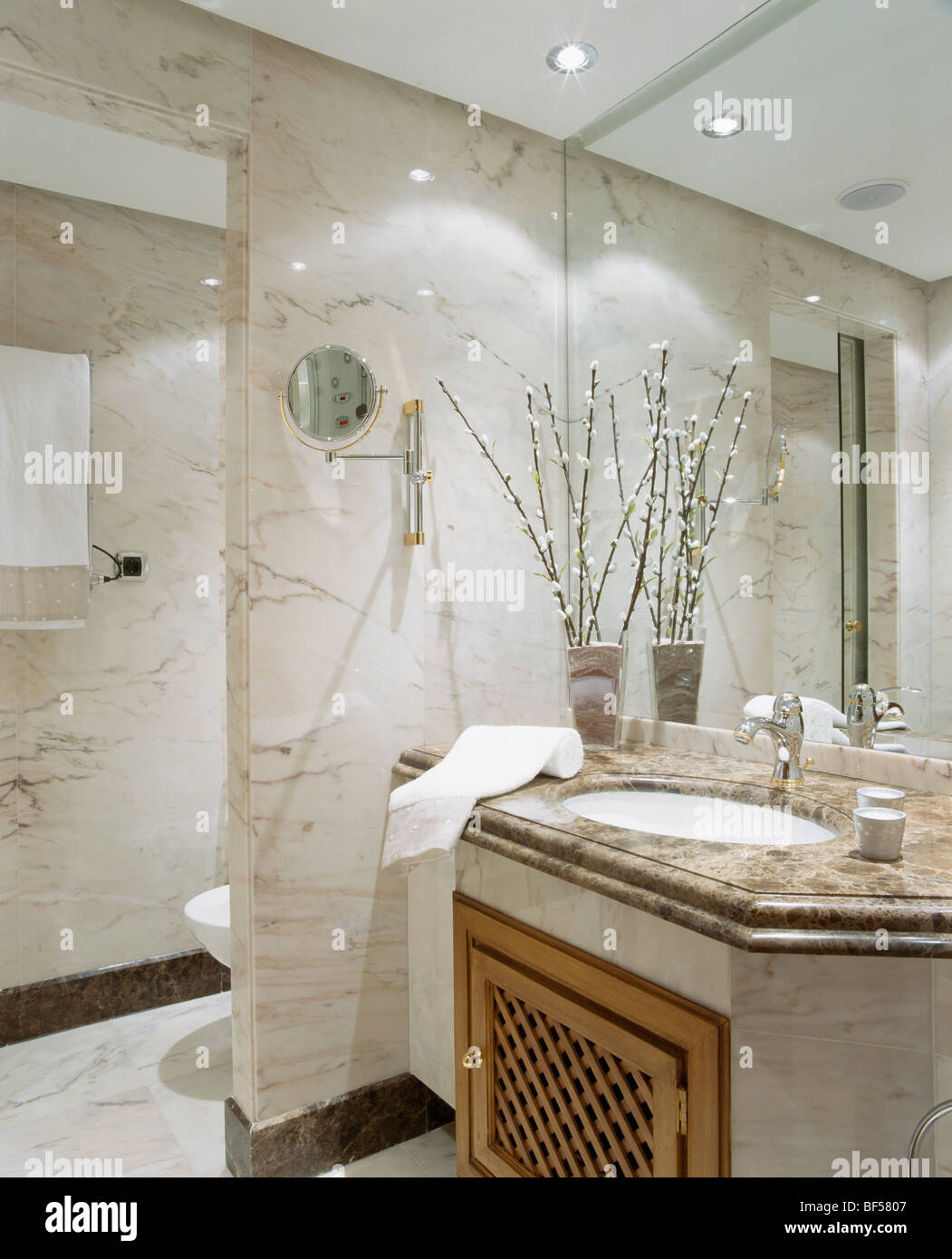 Mirrored Wall Above Basin In Vanity Unit In Modern Marble Bathroom Stock Photo Alamy