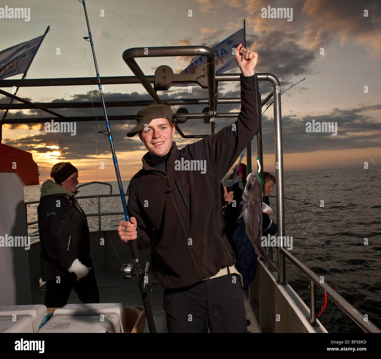 Teenager with cod, North Atlantic, Raufarhofn, Iceland Stock Photo