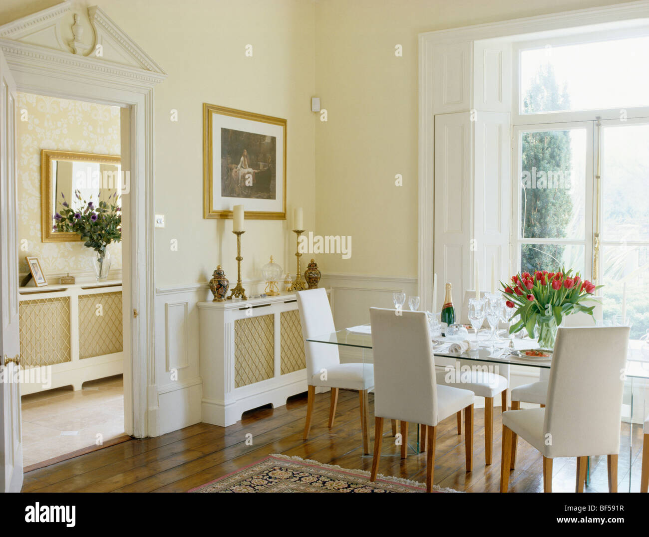 Picture of: White Upholstered Tall Back Chairs And Glass Table In Traditional Stock Photo Alamy
