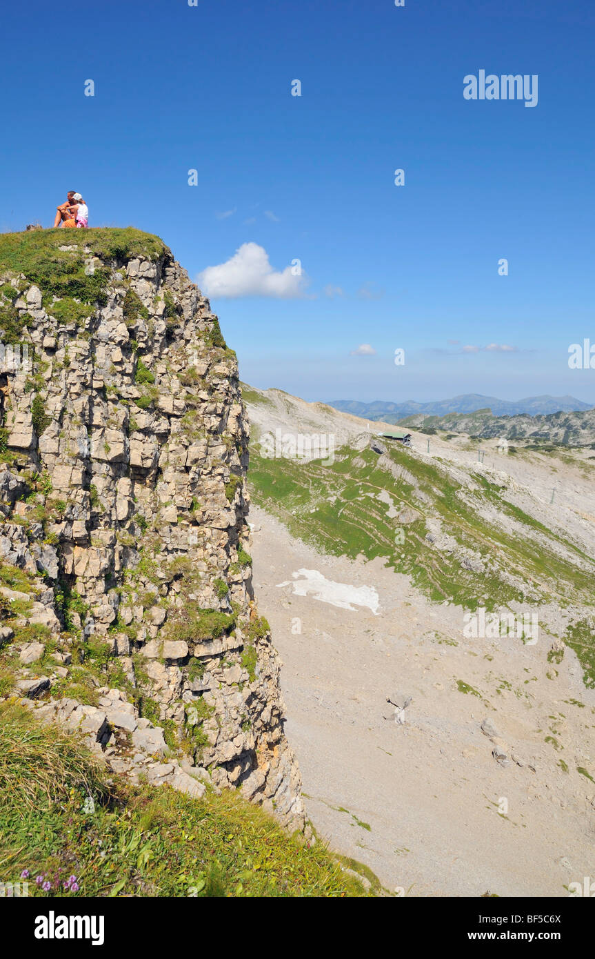 Pause on the way to the summit of the Hoher Ifen Mountain, Vorarlberg, Allgaeu Alps, Austria, Europe - Stock Image