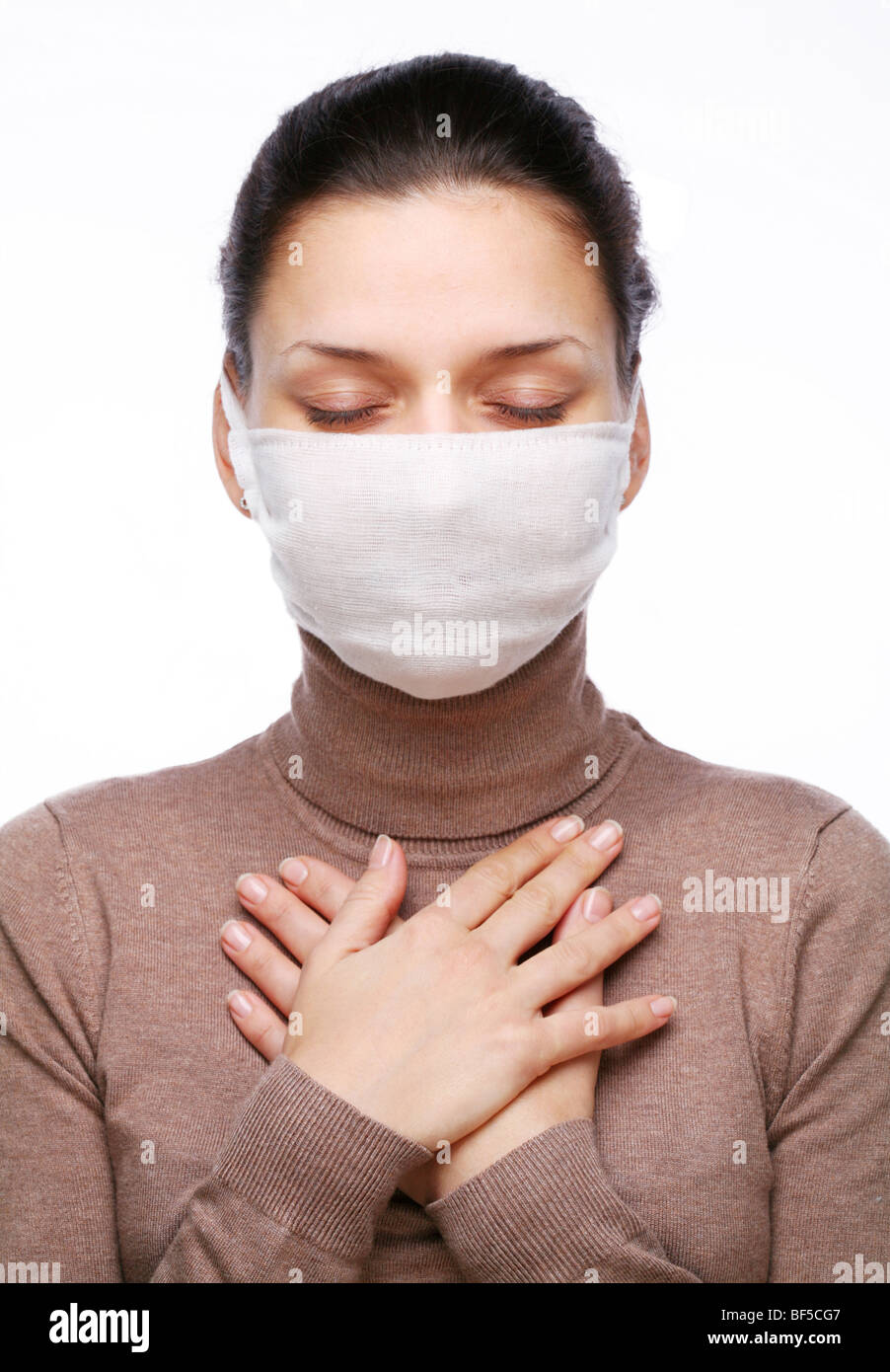 young-woman-in-medical-mask-keeping-hand