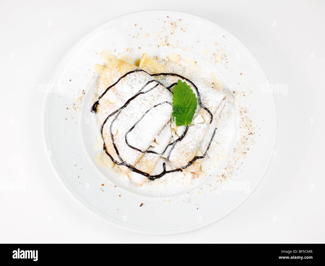 Pancakes with chocolate sauce - Stock Image