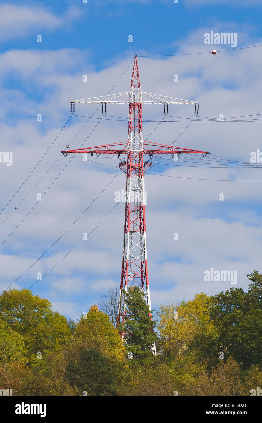 Electricity pylon marked with red and white balls in an aircraft flight path, Germany, Europe - Stock Image