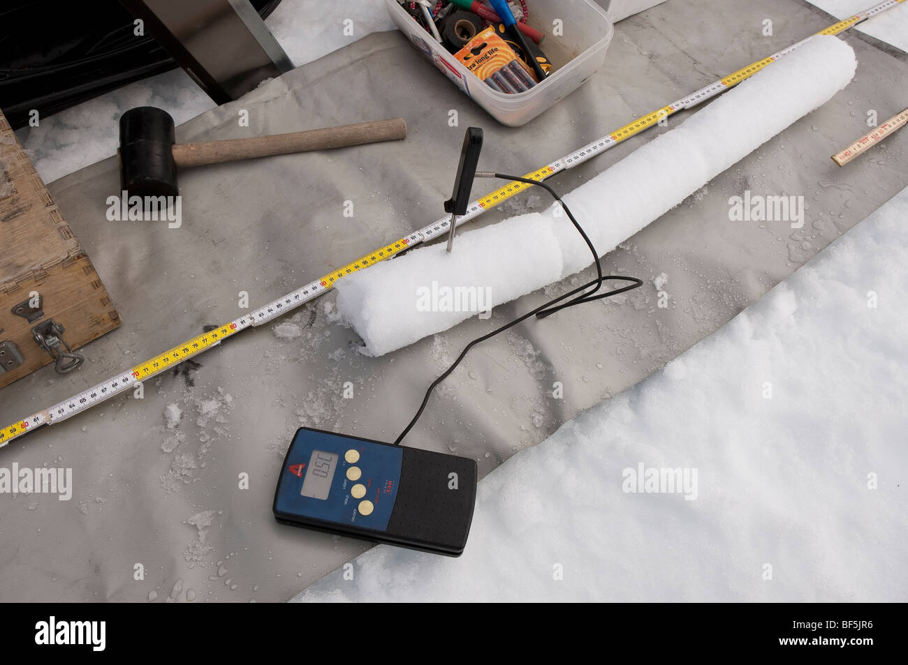 Thermometer measures temperature in ice core sample, Iceland - Stock Image