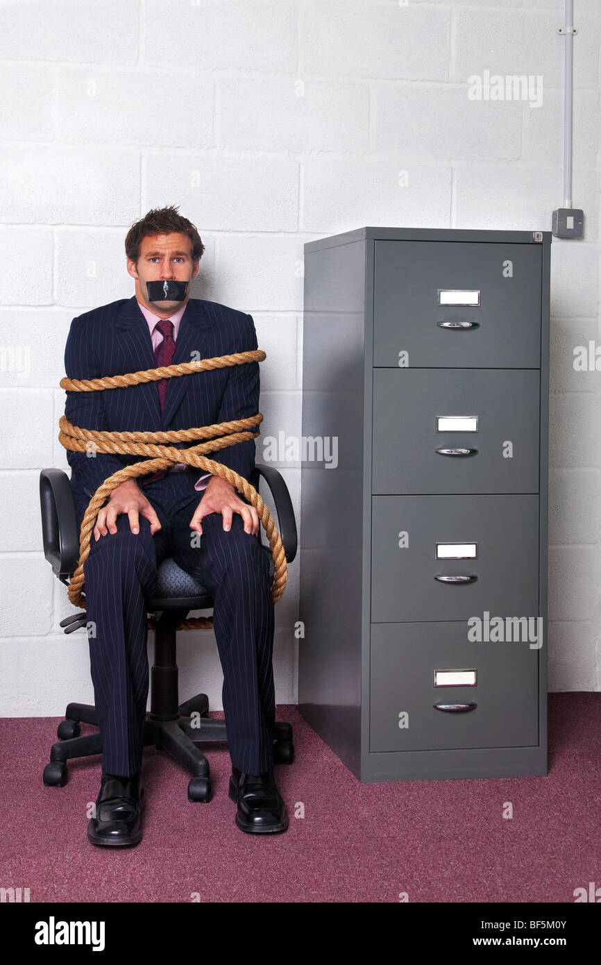 Tied To Chair High Resolution Stock Photography and Images - Alamy