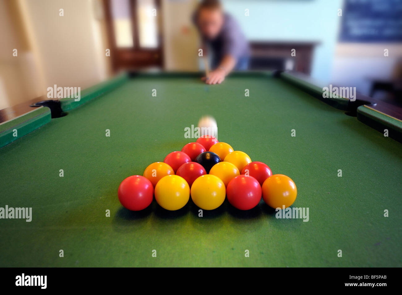 Taking the break in a game of pool - Stock Image