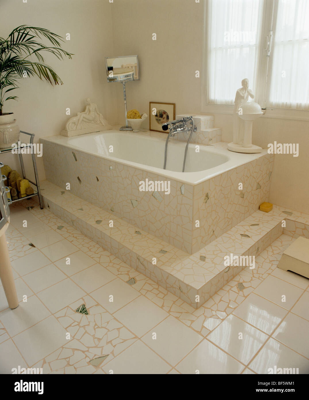 White and mirror-mosaic floor and bath surround in Thirties-style ...