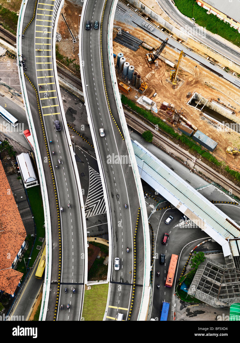 An aerial view of a elevated highway and construction site. - Stock Image