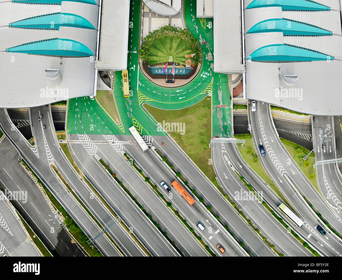 An aerial view of multiple roads leading into a large complex. - Stock Image