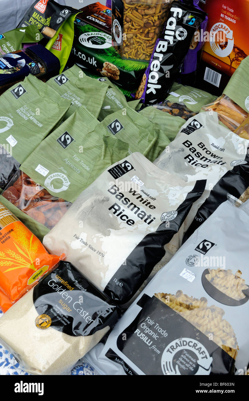 Traidcraft packaged food for sale on stall - Stock Image