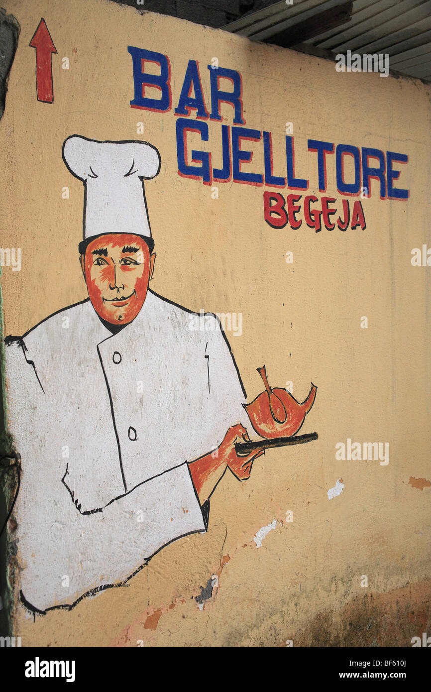 Painted sign for the Bar Gjelltore at the train station in Tirana, Albania - Stock Image