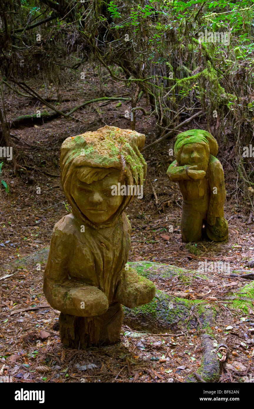 The Little People, redwood carvings from the story of Paul Bunyan, Trees of Mystery, Del Norte County, California - Stock Image