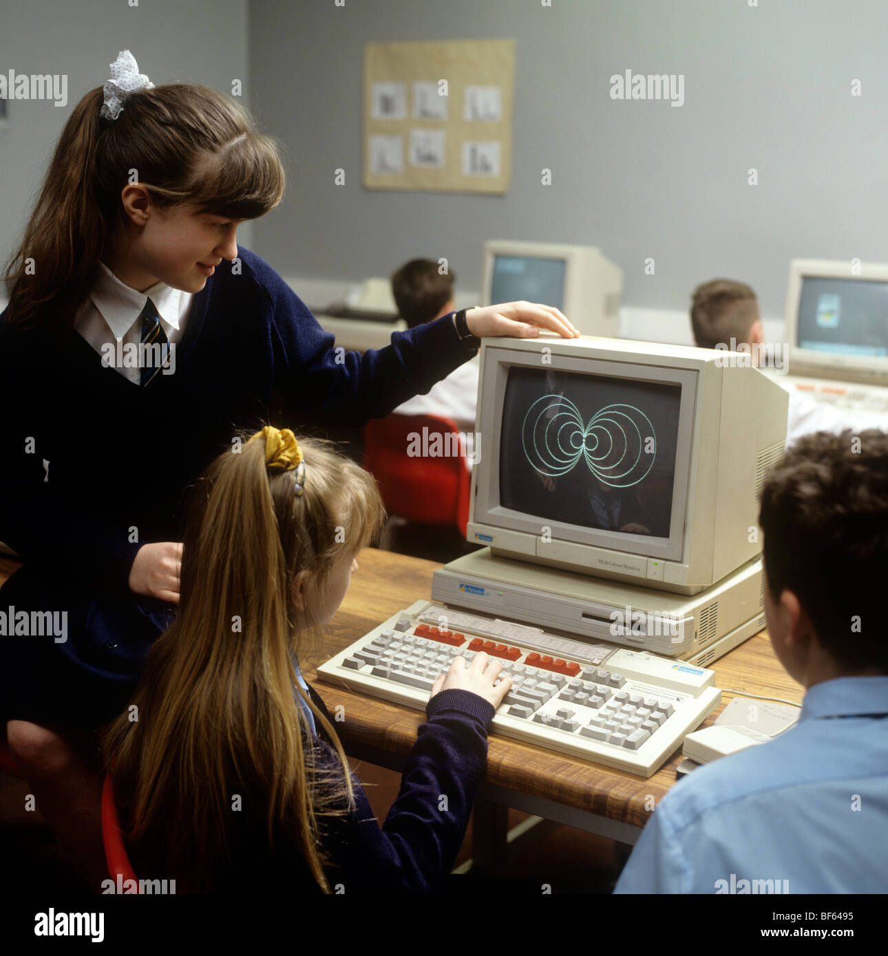 Education schoolchildren using an Archimedes computer in early 1990s - Stock Image