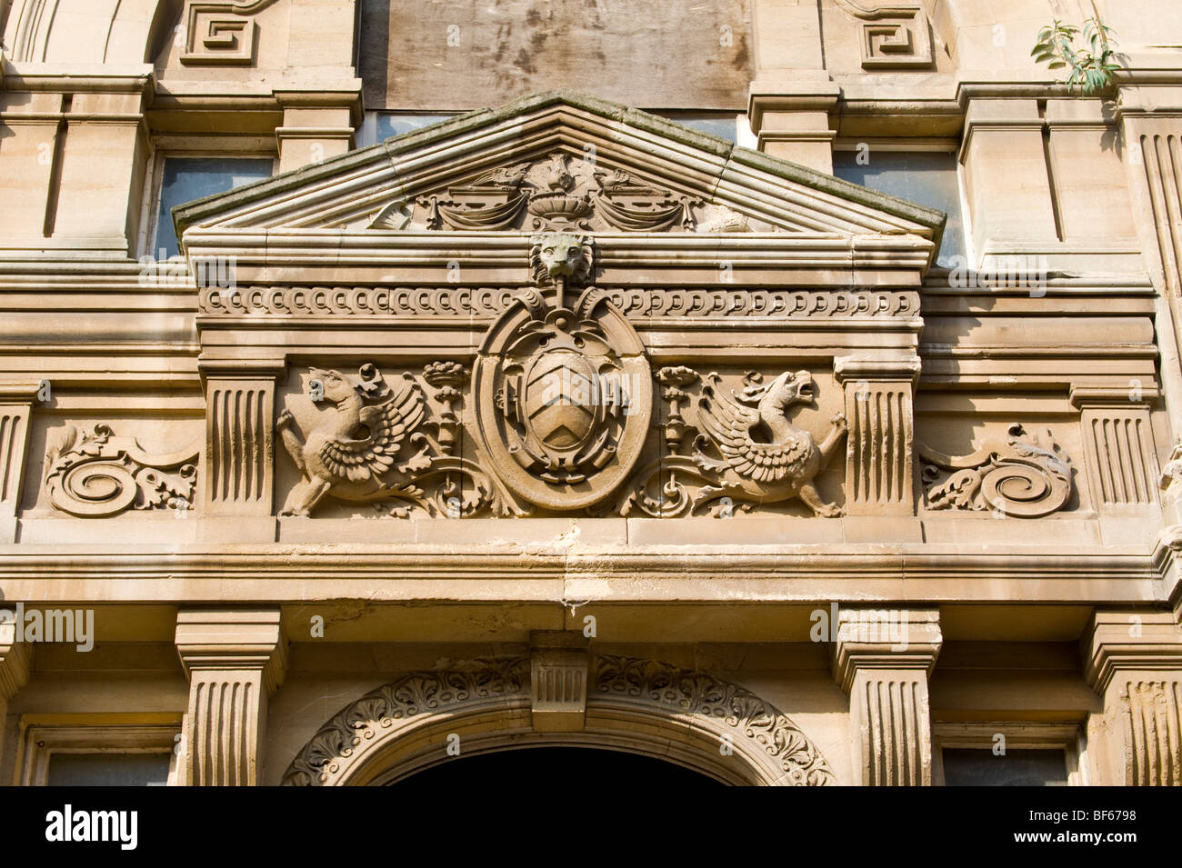 Architectural detail of ornate pediment over doorway on building in Mount Stuart Square Cardiff Bay South Wales Stock Photo