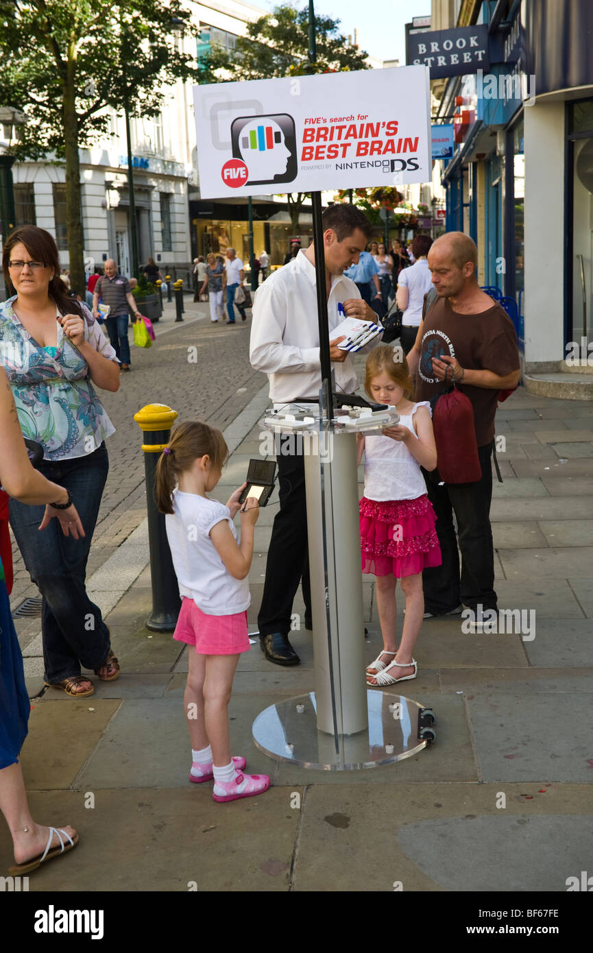 Nintendo DS searching for Britains best brain in street in city of Newport South Wales UK - Stock Image