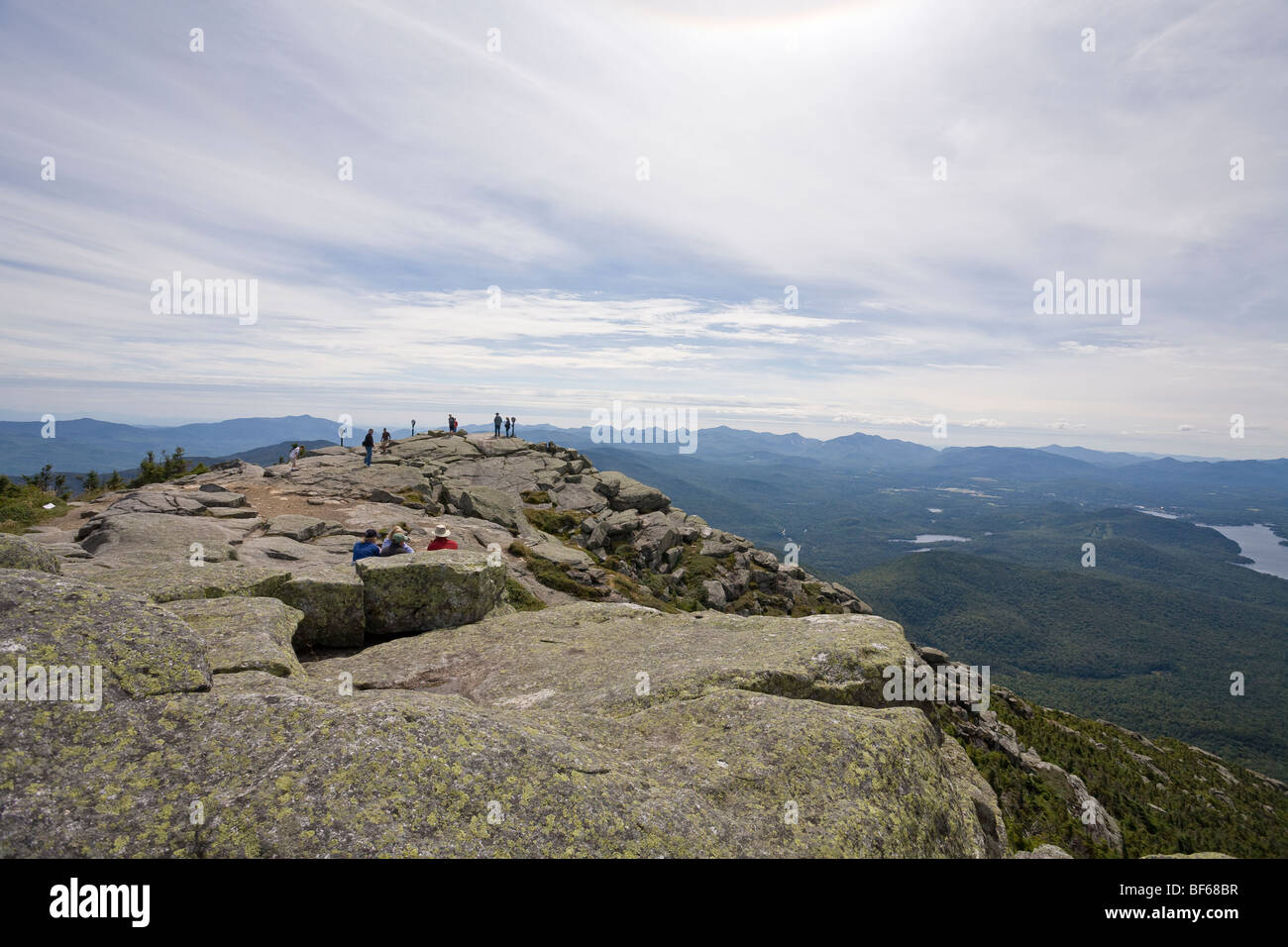 Whiteface View from the peak. Visitors to the famous mountain peak wander about and enjoy view of the Adirondack - Stock Image