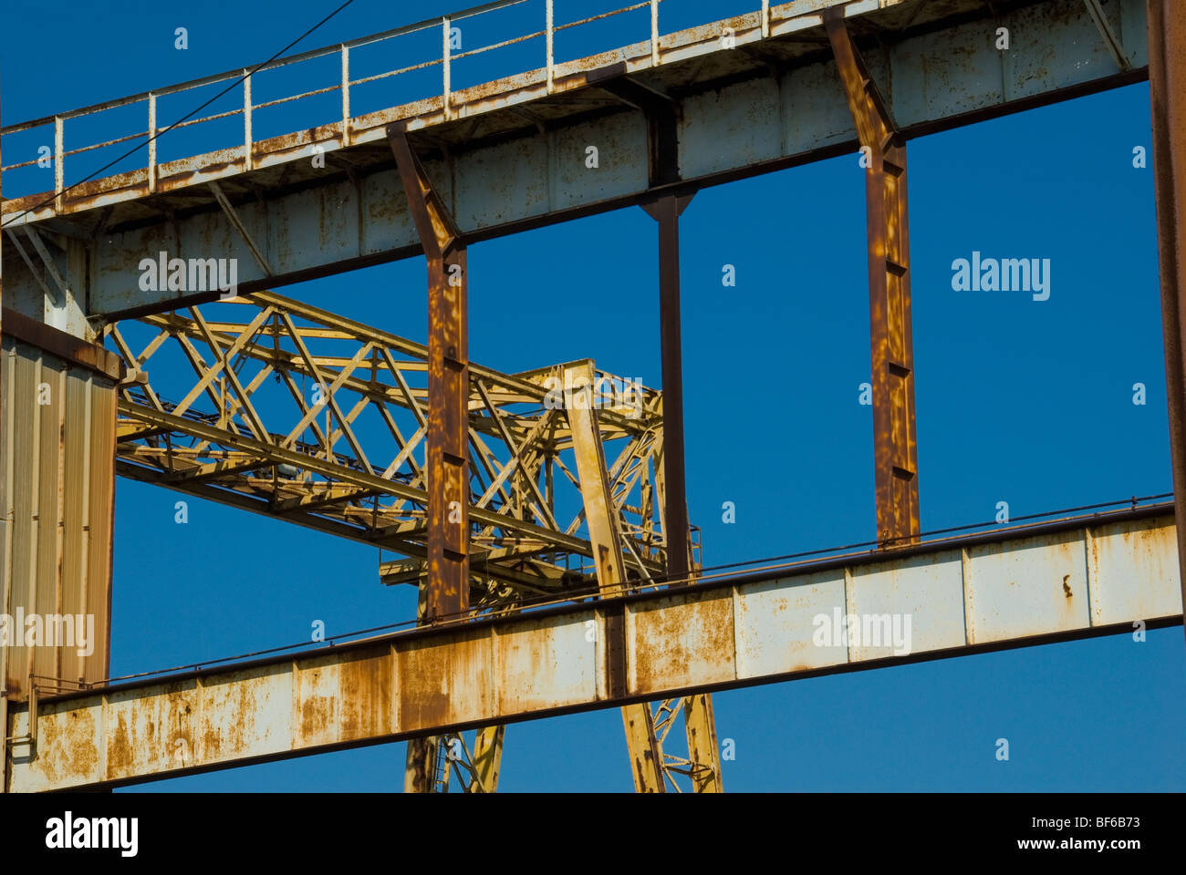 The steelwork of a crane in a disused boat yard in Savona Northern Italy - Stock Image