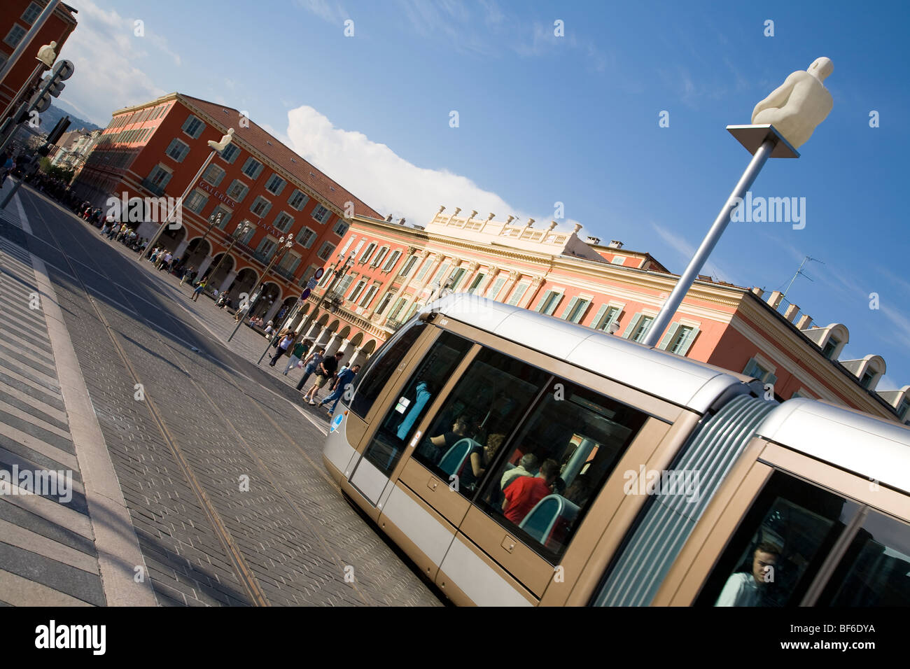 Place Massena, Streetcar Line T1, Artwork from J. Plensa ( Conversation Nice ), Nice, Cote D Azur, Provence, France - Stock Image