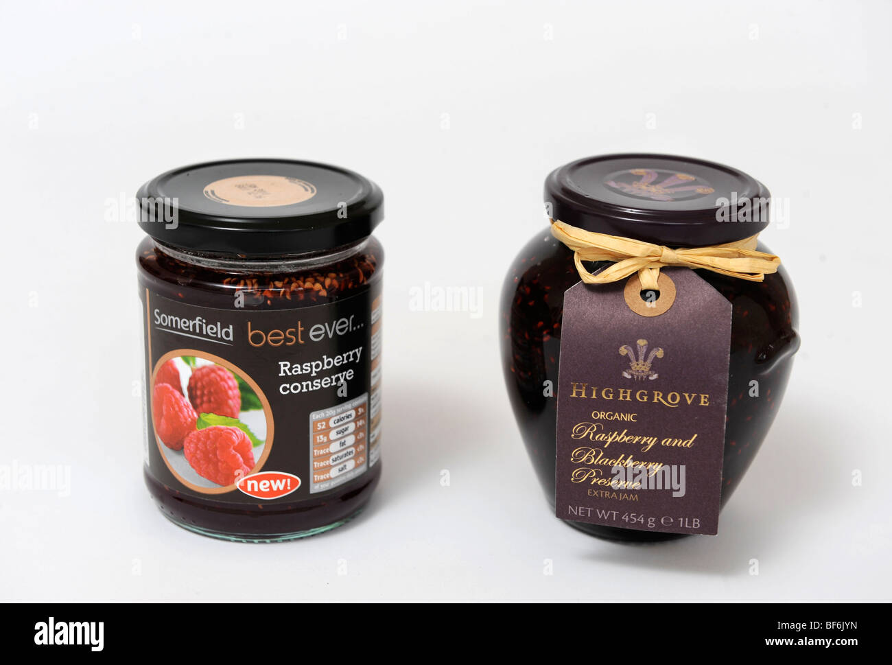 Alternative examples of similar fruit jam products Raspberry Conserve from Somerfield supermarket (left) and Raspberry - Stock Image