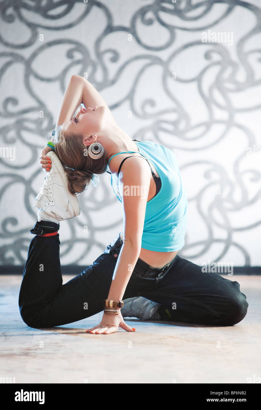 Young woman gymnastics. Soft bright light. - Stock Image