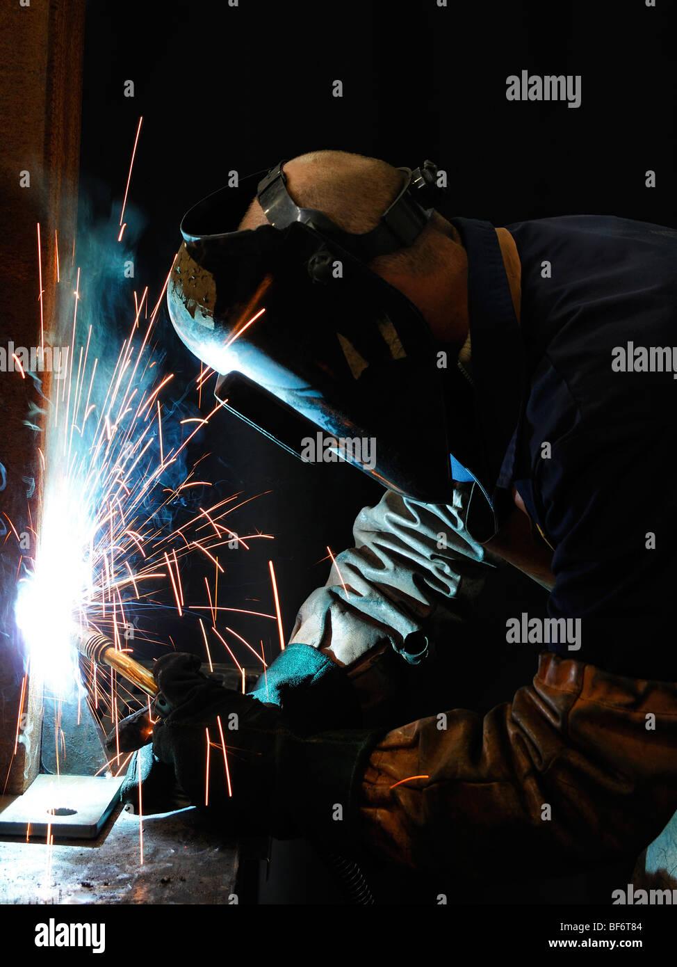 Welder Welding at an Engineering Works - Stock Image