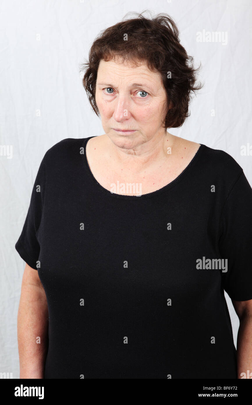 50s 60s woman looking serious staring stern facial expression austere sombre determined focused solemn pensive - Stock Image