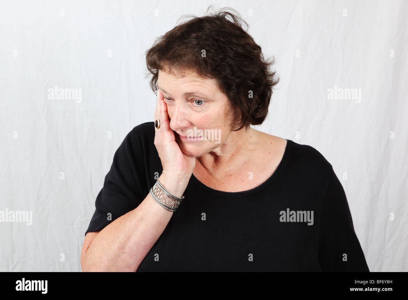 50s 60s woman looking anxious nervous apprehensive distressed disturbed  worried uneasy restless unsettled - Stock Image