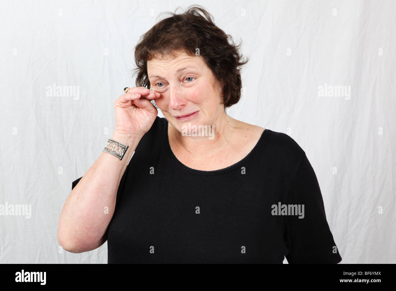 50s 60s late middle aged woman crying looking sad tearful upset depressed down distressed unsettled troubled worried - Stock Image