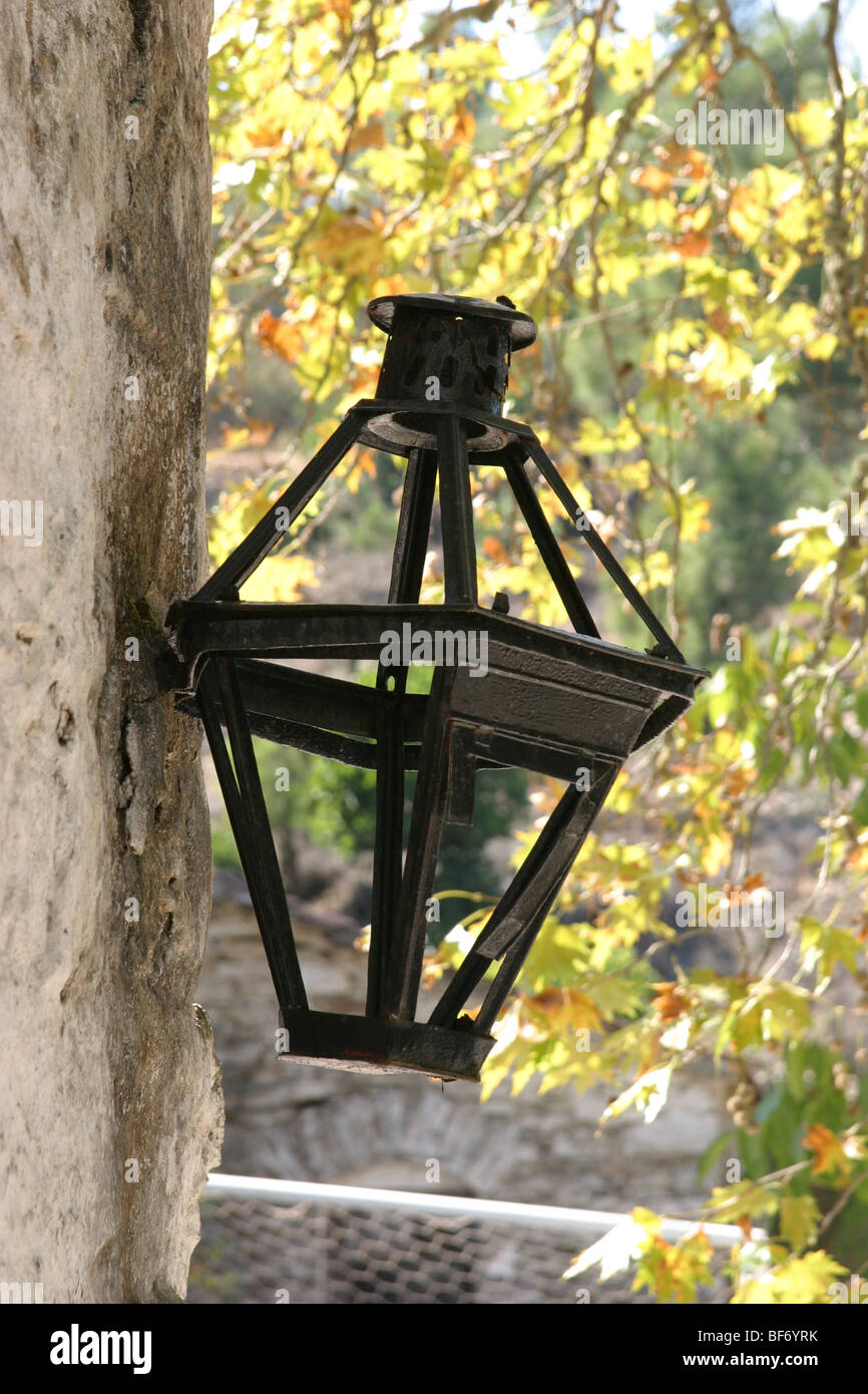 wall lamp on a churchyard building - Stock Image