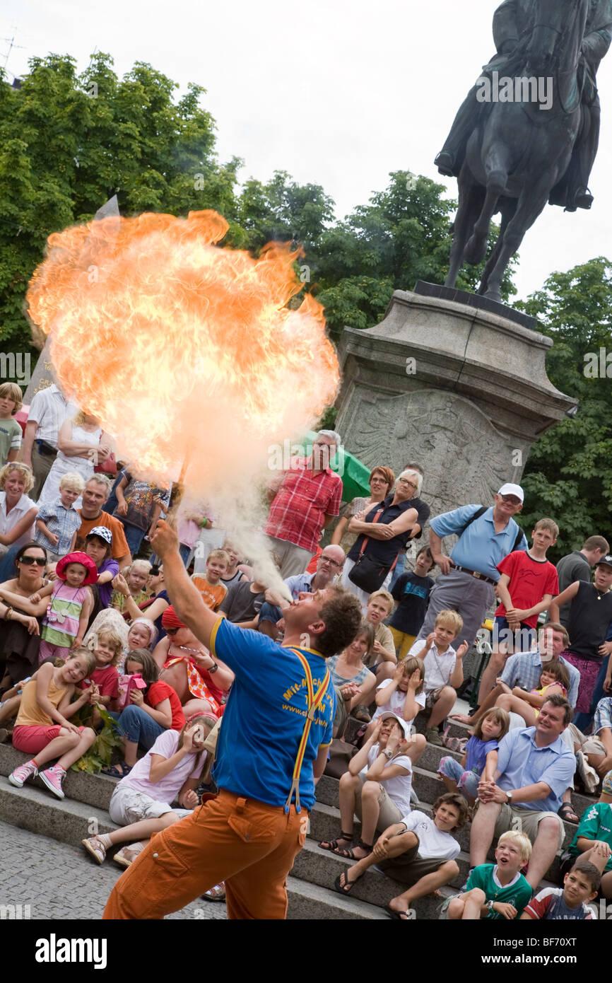 Clown Josh at the Karlsplatz place in Stuttgart, fire-eater, program for kids, Baden-Wurttemberg, Germany - Stock Image