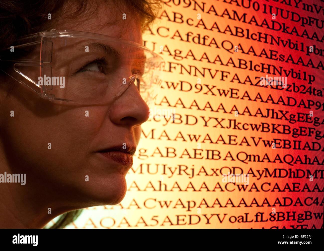 woman computer technician examining code - Stock Image