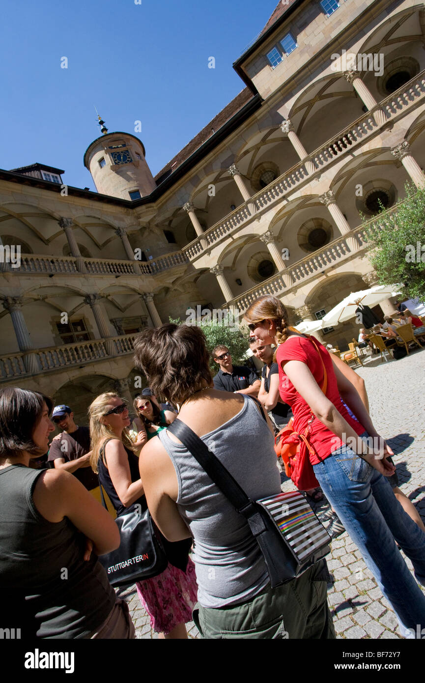 Group of people with a tour guide at the Old Castle in Stuttgart,  Baden-Wurttemberg, Germany - Stock Image