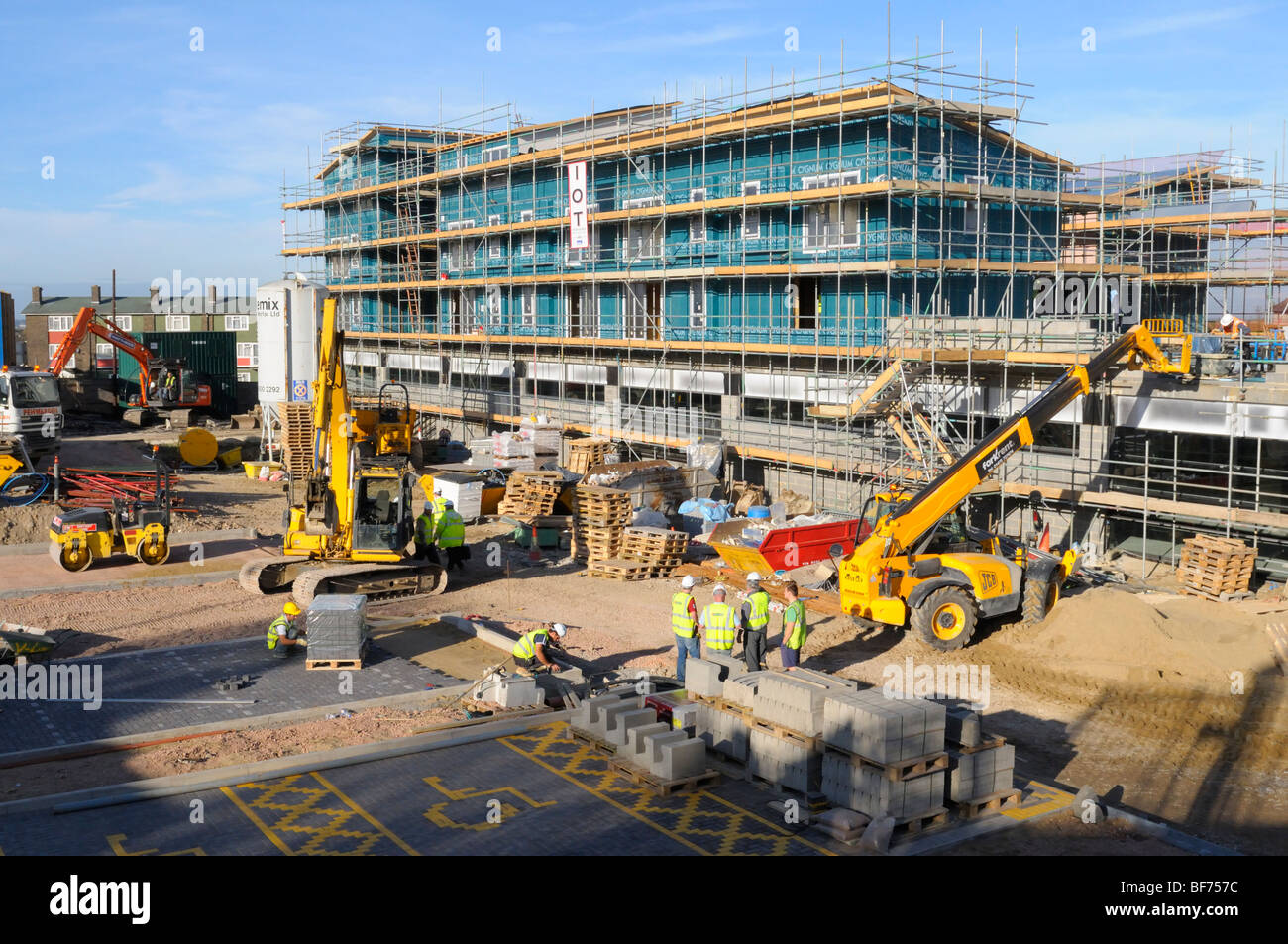 Laying block paving on building site for new Lidl supermarket Croydon Surrey England UK - Stock Image