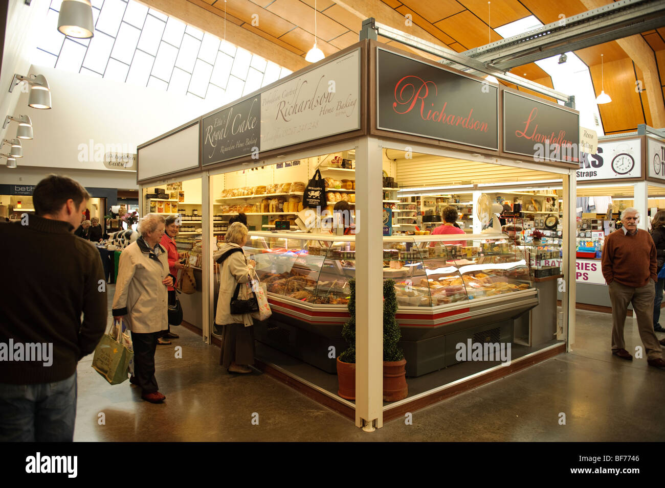 Stalls and shoppers inside the new Carmarthen indoor market, Wales UK, 2009 - Stock Image
