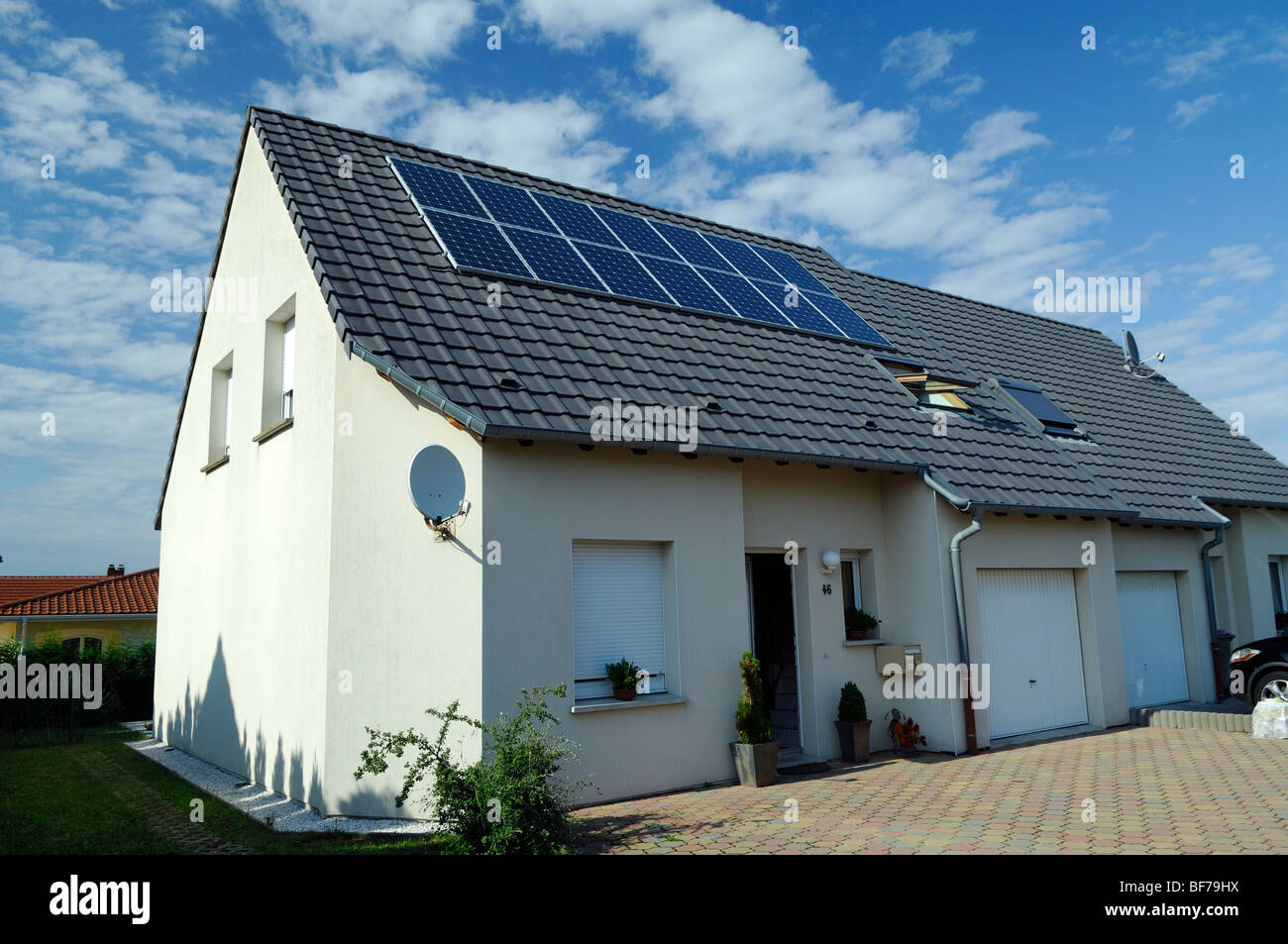 photovoltaic solar power energy panels on the roof of a private house - Stock Image