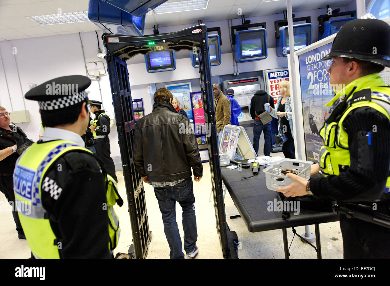 British Transport Police using the 'Knife Arch' detector during routine neighborhood policing at Lewisham - Stock Image