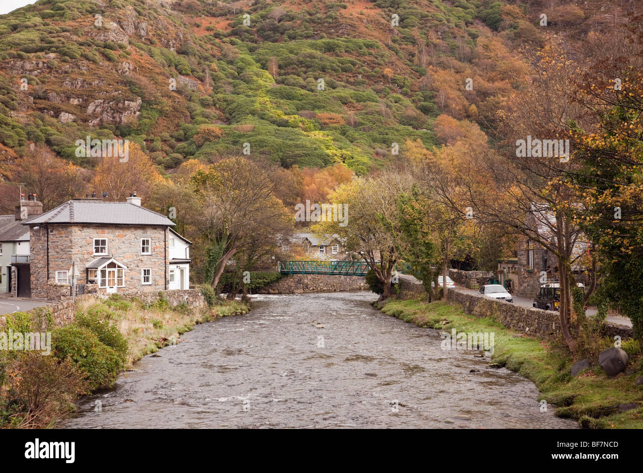 Beddgelert Gwynedd North Wales UK. View along Afon Colwyn River in village in mountains of Snowdonia 'National - Stock Image