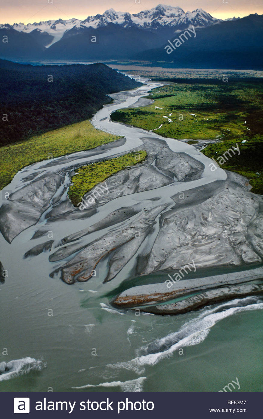 River draining meltwater from glacier, Westland National Park, New Zealand - Stock Image