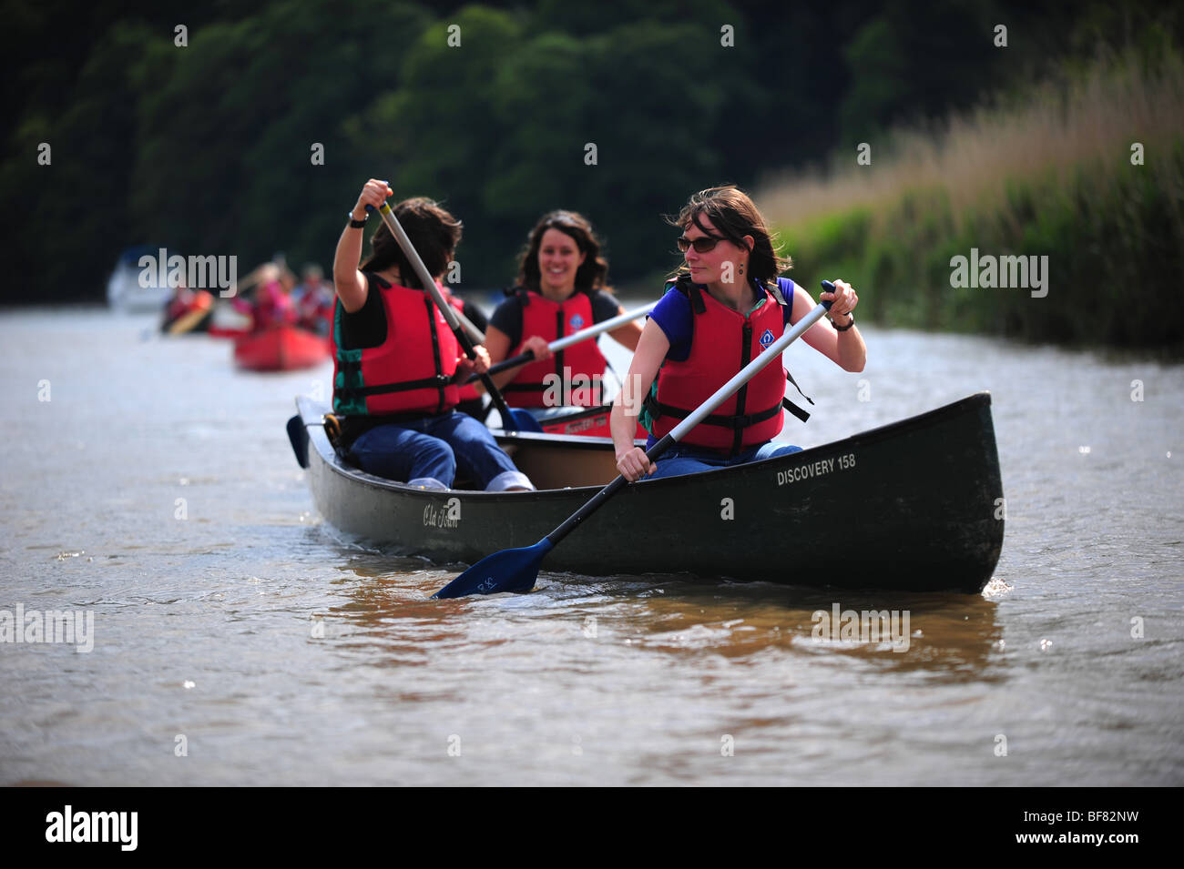 Young girls canoeing and kayaking on the river Tamar, on the Devon and Cornwall border, UK Stock Photo