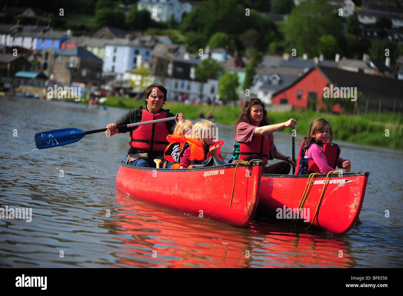 A family canoeing and kayaking on the River Tamar, on the Devon and Cornwall border, UK Stock Photo