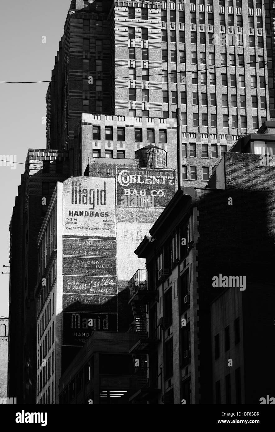 Old painted adverts on the side of buildings, Manhattan, New York, USA - Stock Image