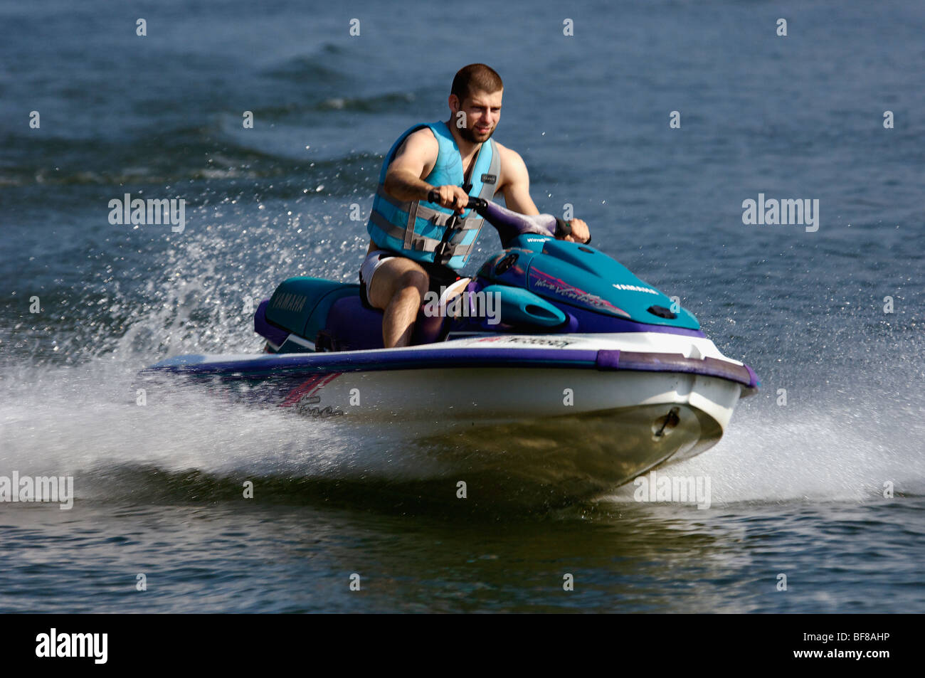 Young Man Riding Jet Ski on Watts Bar Lake in Rhea County, Tennessee - Stock Image