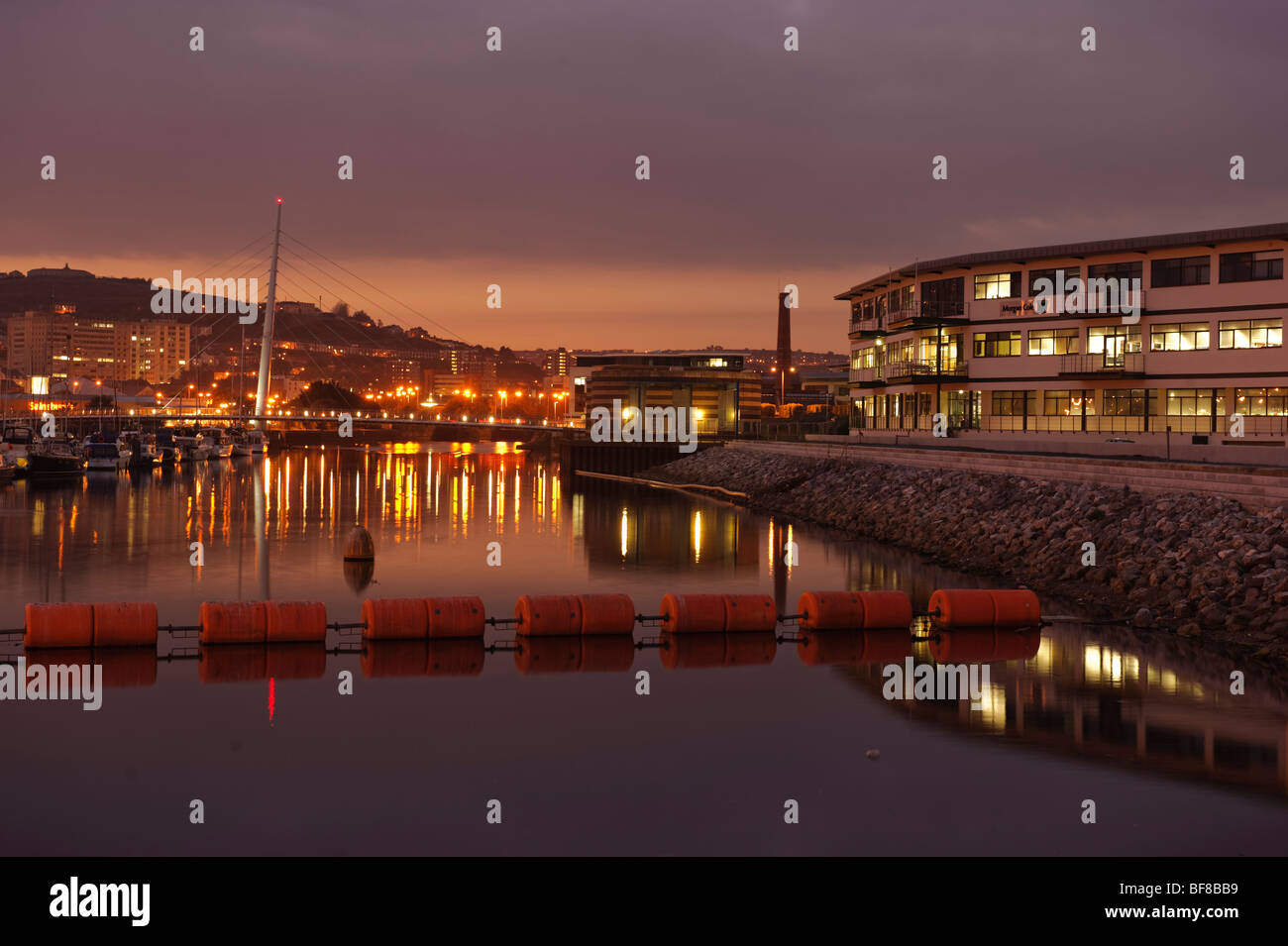 Swansea SA1 docklands redevelopment zone at night, Wales UK - Stock Image