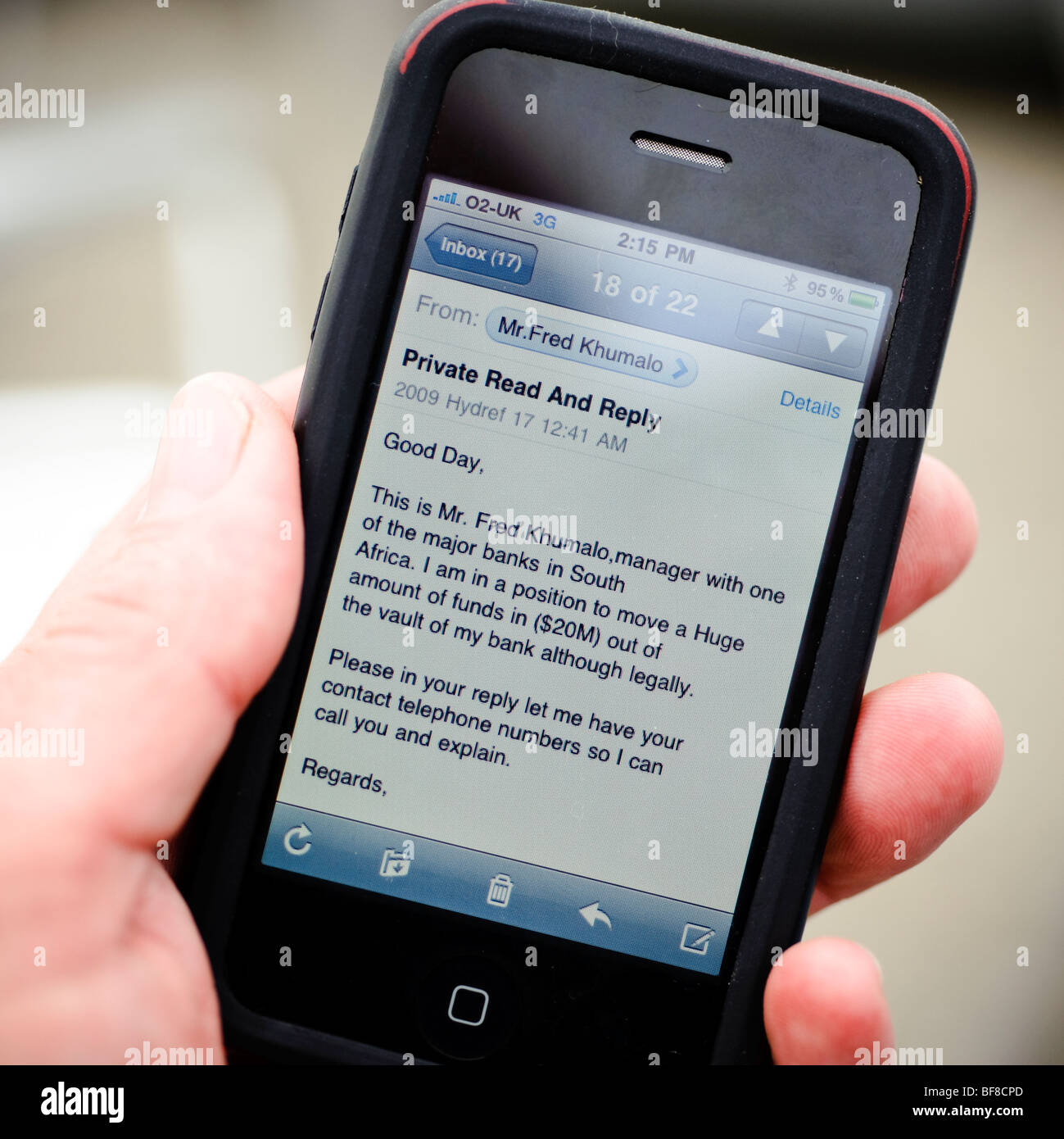reading a phishing email fraud scam letter on an apple iPhone, UK - Stock Image