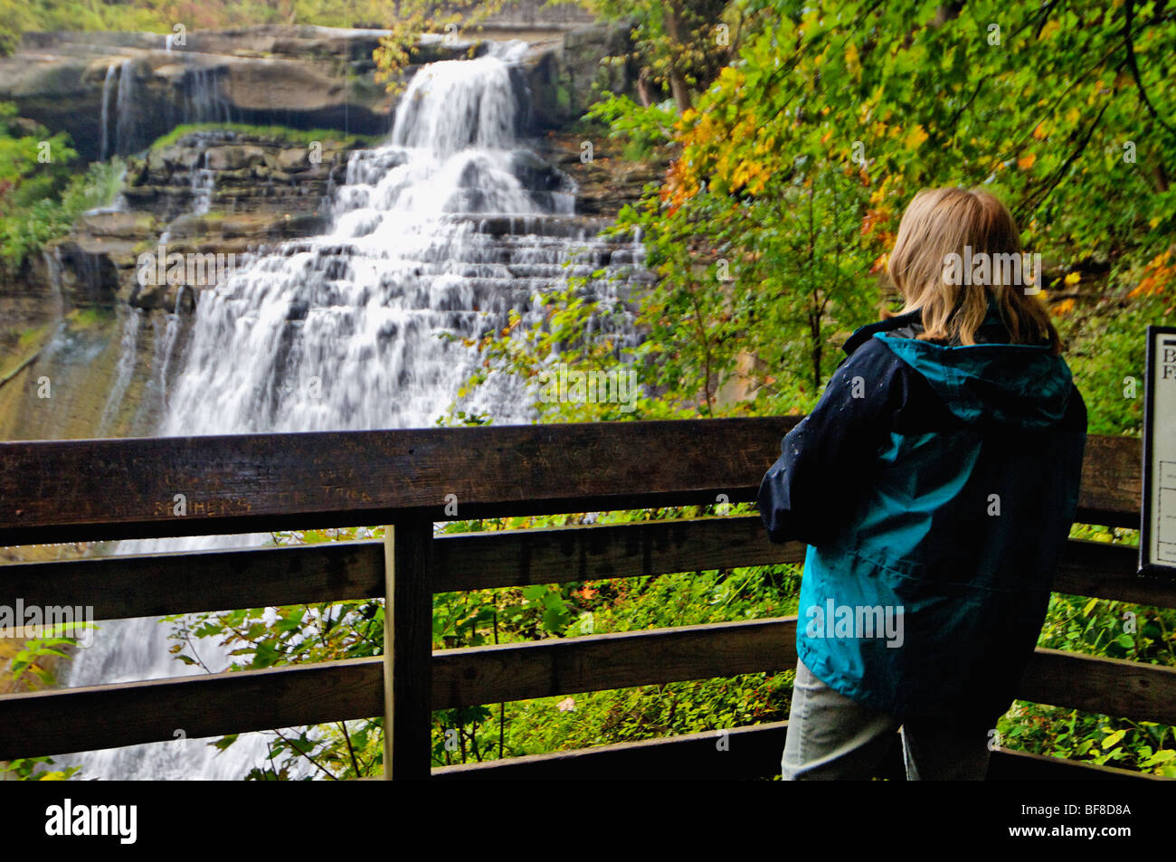 Woman Viewing Brandywine Falls in Cuyahoga Valley National Park in Ohio - Stock Image