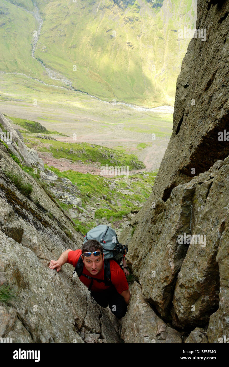 A climber 'Threading the Needle' (climbing behind Napes Needle) in Wasdale, Lake District - Stock Image